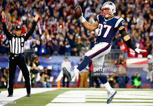 Rob Gronkowski of the New England Patriots celebrates after scoring a touchdown during the third quarter against the Cincinnati Bengals at Gillette...