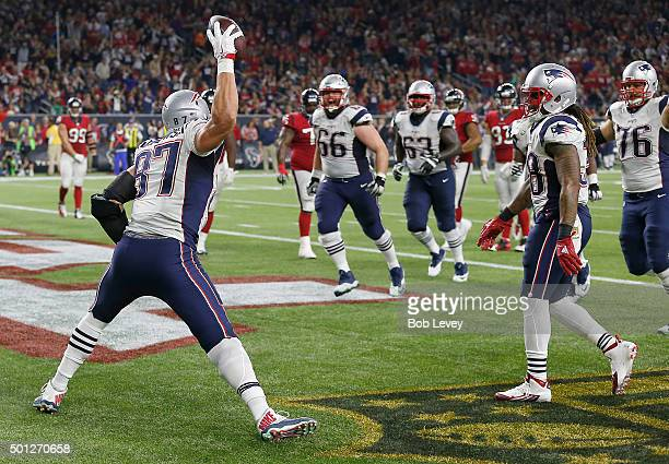 Rob Gronkowski of the New England Patriots celebrates catches touchdown pass against Quintin Demps of the Houston Texans in the second quarter on...