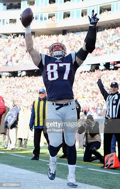 Rob Gronkowski of the New England Patriots celebrates scoring a touchdown during the first quarter against the Tennessee Titans at Gillette Stadium...