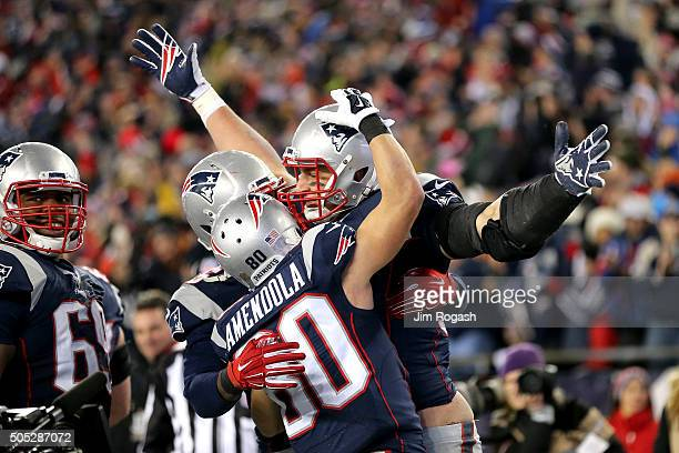 Rob Gronkowski of the New England Patriots celebrates scoring his second touchdown with teammates in the third quarter against the Kansas City Chiefs...
