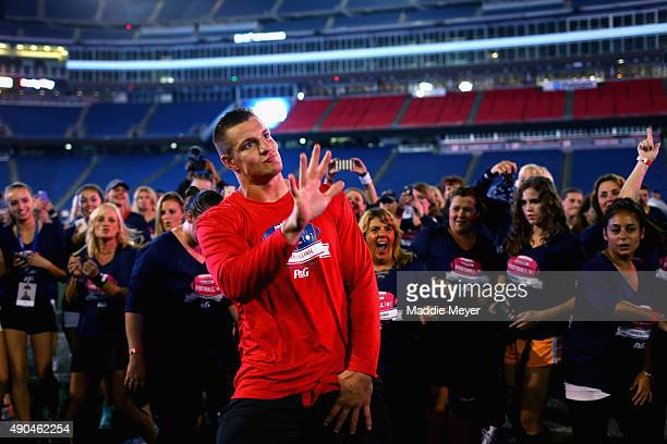Rob Gronkowski of the New England Patriots dances with clinic participants during The Rob Gronkowski Football 101 Women's Clinic at Gillette Stadium...