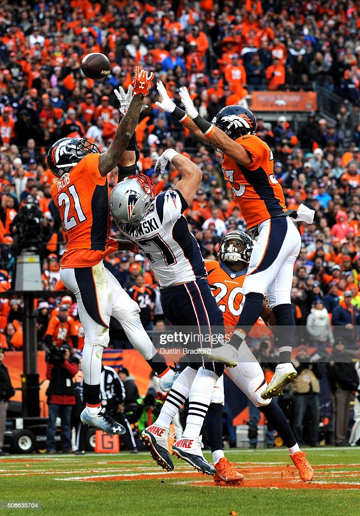 Rob Gronkowski #87 of the New England Patriots fails to make a catch in the fourth quarter against Aqib Talib #21 and Shiloh Keo #33 of the Denver Broncos in the AFC Championship game at Sports Authority Field at Mile High on January 24, 2016 in Denver, Colorado.