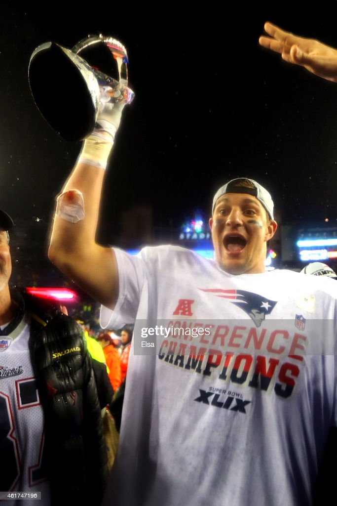 <a gi-track='captionPersonalityLinkClicked' href=/galleries/search?phrase=Rob+Gronkowski&family=editorial&specificpeople=5534525 ng-click='$event.stopPropagation()'>Rob Gronkowski</a> #87 of the New England Patriots holds the Lamar Hunt Trophy after defeating the Indianapolis Colts in the 2015 AFC Championship Game at Gillette Stadium on January 18, 2015 in Foxboro, Massachusetts. The Patriots defeated the Colts 45-7.