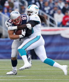 Rob Gronkowski of the New England Patriots is tackled by Dannell Ellerbe of the Miami Dolphins in the first half at Gillette Stadium on October 27...