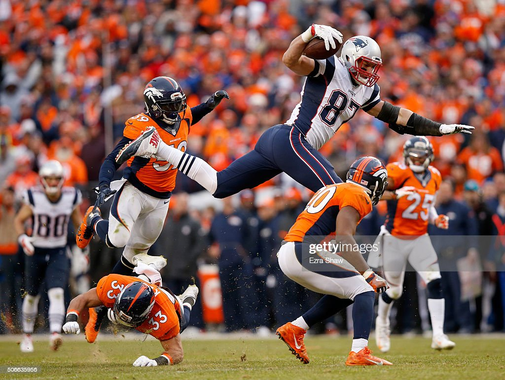 <a gi-track='captionPersonalityLinkClicked' href=/galleries/search?phrase=Rob+Gronkowski&family=editorial&specificpeople=5534525 ng-click='$event.stopPropagation()'>Rob Gronkowski</a> #87 of the New England Patriots is tackled by <a gi-track='captionPersonalityLinkClicked' href=/galleries/search?phrase=Josh+Bush+-+American+Football+Player&family=editorial&specificpeople=11366224 ng-click='$event.stopPropagation()'>Josh Bush</a> #20, <a gi-track='captionPersonalityLinkClicked' href=/galleries/search?phrase=Shiloh+Keo&family=editorial&specificpeople=4485168 ng-click='$event.stopPropagation()'>Shiloh Keo</a> #33 and <a gi-track='captionPersonalityLinkClicked' href=/galleries/search?phrase=Danny+Trevathan&family=editorial&specificpeople=6475347 ng-click='$event.stopPropagation()'>Danny Trevathan</a> #59 of the Denver Broncos in the fourth quarter in the AFC Championship game at Sports Authority Field at Mile High on January 24, 2016 in Denver, Colorado.