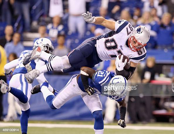Rob Gronkowski of the New England Patriots leaps to score a touchdown during the game against the Indianapolis Colts at Lucas Oil Stadium on November...