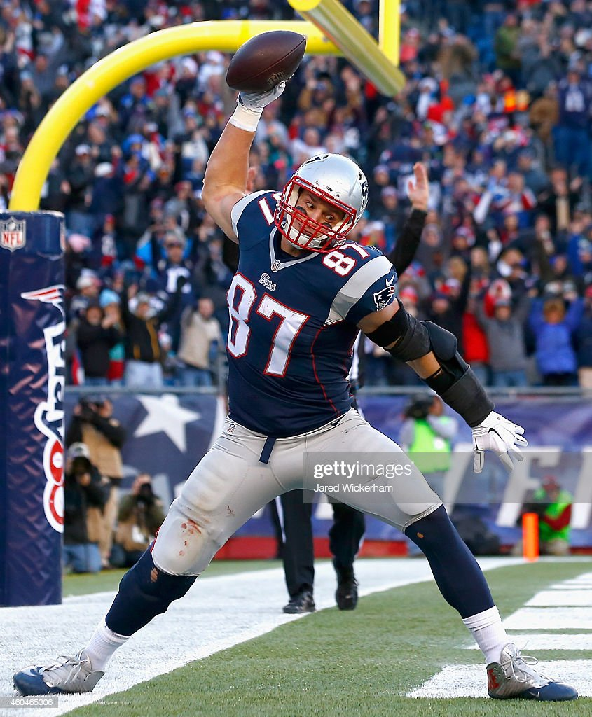 <a gi-track='captionPersonalityLinkClicked' href=/galleries/search?phrase=Rob+Gronkowski&family=editorial&specificpeople=5534525 ng-click='$event.stopPropagation()'>Rob Gronkowski</a> #87 of the New England Patriots reacts after catching a touchdown pass during the third quarter against the Miami Dolphins at Gillette Stadium on December 14, 2014 in Foxboro, Massachusetts.