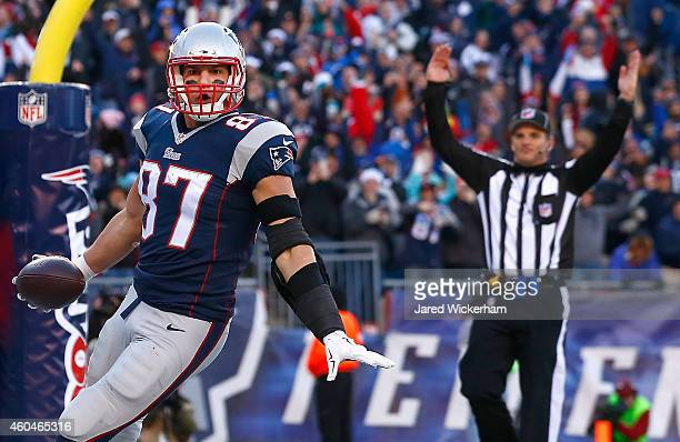 Rob Gronkowski of the New England Patriots reacts after catching a touchdown pass during the third quarter against the Miami Dolphins at Gillette...