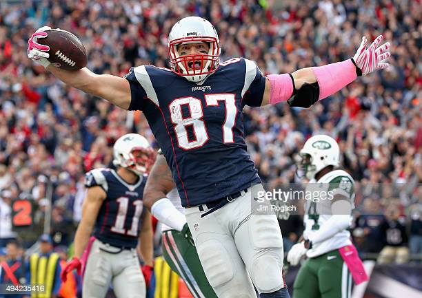 Rob Gronkowski of the New England Patriots reacts after scoring a touchdown during the fourth quarter against the New York Jets at Gillette Stadium...