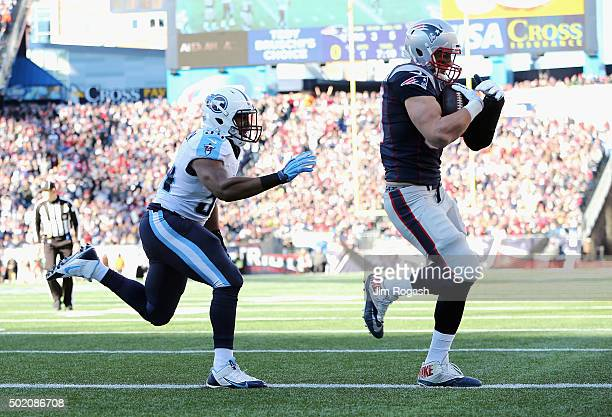 Rob Gronkowski of the New England Patriots scores a touchdown during the first quarter against the Tennessee Titans at Gillette Stadium on December...
