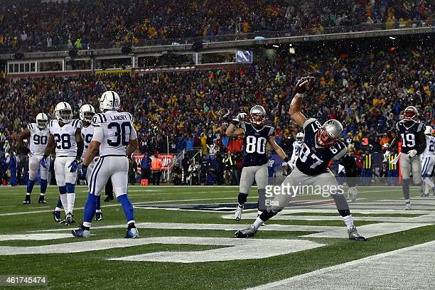 Rob Gronkowski of the New England Patriots spikes the ball after his third quarter touchdown against the Indianapolis Colts of the 2015 AFC...