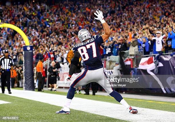 Rob Gronkowski of the New England Patriots spikes the ball to celebrate his touchdown in the second quarter against the Pittsburgh Steelers at...