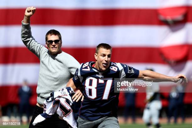 Rob Gronkowski of the New England Patriots steals Tom Brady's jersey before the opening day game between the Boston Red Sox and the Pittsburgh...