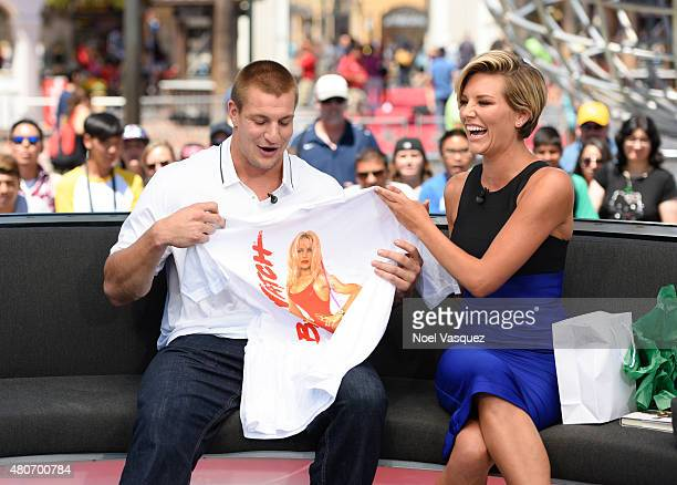 Rob Gronkowski receives a gift from Charissa Thompson at 'Extra' at Universal Studios Hollywood on July 14 2015 in Universal City California
