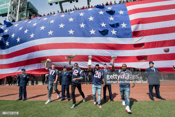 Rob Gronkowski Tom Brady James White and Dion Lewis of and the New England Patriots take the field during a ceremony in recognition of their Super...