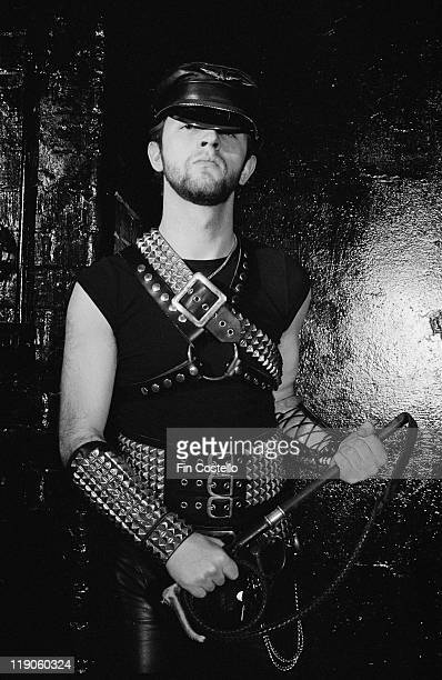 Rob Halford British singersongwriter and lead singer with heavy metal band Judas Priest poses wearing a leather cap and studded leather cuffs and...