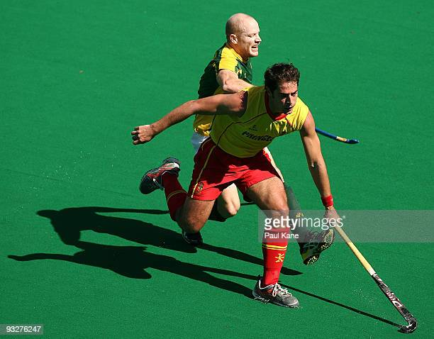 Rob Hammond of Australia and Alex Fabregas of Spain contest the ball during the first test match between the Australian Kookaburras and Spain at...