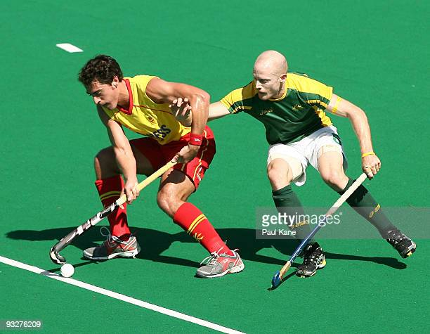 Rob Hammond of Australia challenges Alex Fabregas of Spain during the first test match between the Australian Kookaburras and Spain at Perth Hockey...