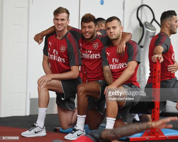 Rob Holding Alex OxladeChamberlain and Jack Wilshere of Arsenal during a training session at London Colney on July 26 2017 in St Albans England