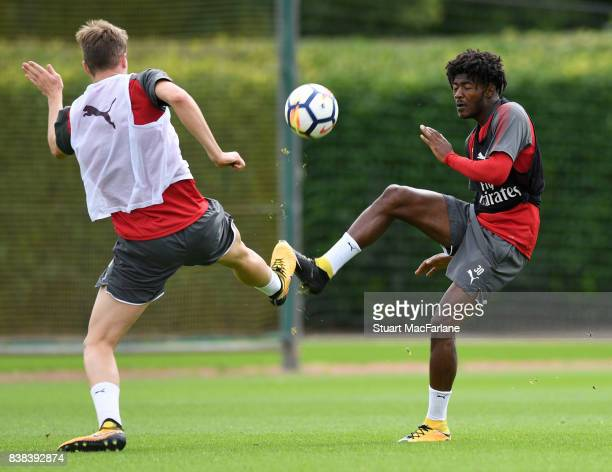 Rob Holding and Ainsley MaitlandNiles of Arsenal during a training session at London Colney on August 24 2017 in St Albans England