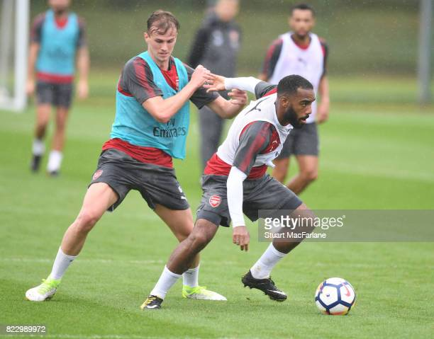 Rob Holding and Alex Lacazette of Arsenal during a training session at London Colney on July 26 2017 in St Albans England