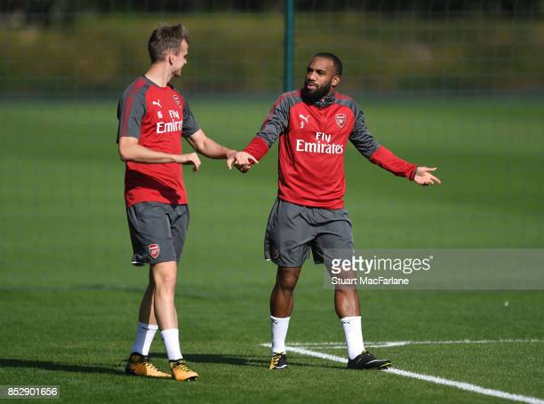 Rob Holding and Alex Lacazette of Arsenal during a training session at London Colney on September 24 2017 in St Albans England