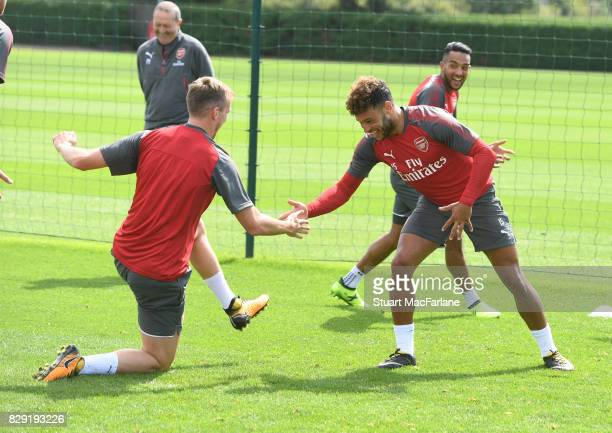 Rob Holding and Alex OxladeChamberlain of Arsenal during a training session at London Colney on August 10 2017 in St Albans England