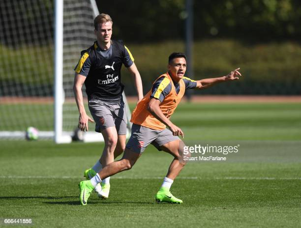 Rob Holding and Alexis Sanchez of Arsenal during a training session at London Colney on April 9 2017 in St Albans England
