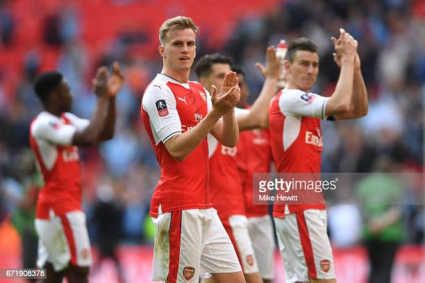 Rob Holding and Arsenal players applaud supporters after the Emirates FA Cup SemiFinal match between Arsenal and Manchester City at Wembley Stadium...