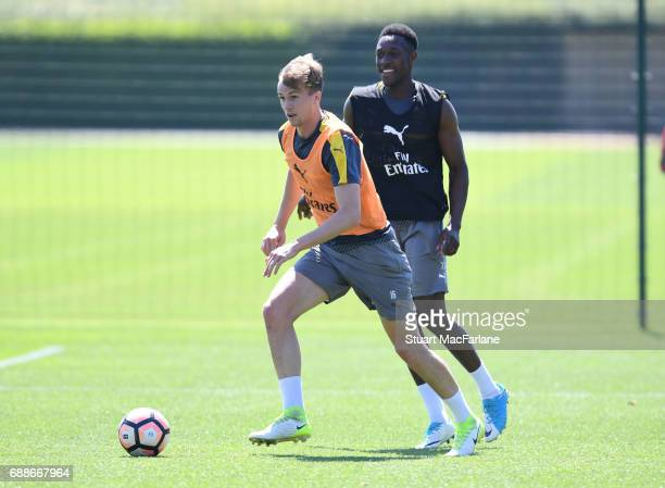 Rob Holding and Danny Welbeck of Arsenal during a training session at London Colney on May 26 2017 in St Albans England