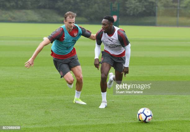 Rob Holding and Danny Welbeck of Arsenal during a training session at London Colney on July 26 2017 in St Albans England