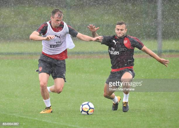 Rob Holding and Jack Wilshere of Arsenal during a training session at London Colney on August 18 2017 in St Albans England