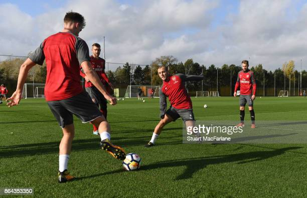 Rob Holding and Jack Wilshere of Arsenal during a training session at London Colney on October 21 2017 in St Albans England