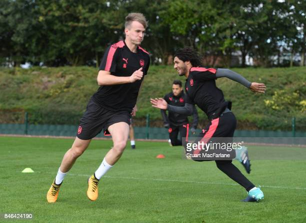 Rob Holding and Mohamed Elneny of Arsenal during a training session at London Colney on September 13 2017 in St Albans England