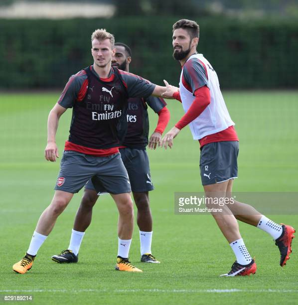 Rob Holding and Olivier Giroud of Arsenal during a training session at London Colney on August 10 2017 in St Albans England