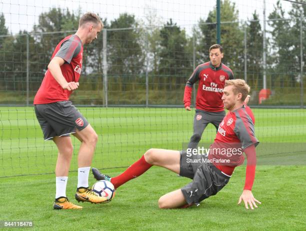 Rob Holding and Per Mertesacker of Arsenal during a training session at London Colney on September 8 2017 in St Albans England
