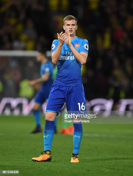 Rob Holding applauds the Arsenal fans after the Premier League match between Watford and Arsenal at Vicarage Road on October 14 2017 in Watford...