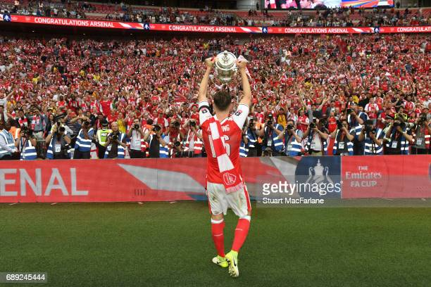 Rob Holding celebrates with the Arsenal fans after the Emirates FA Cup Final between Arsenal and Chelsea at Wembley Stadium on May 27 2017 in London...