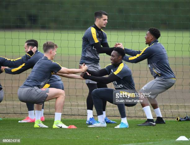 Rob Holding Granit Xhaka Danny Welbeck and Alex Iwobi of Arsenal during a training session at London Colney on May 9 2017 in St Albans England