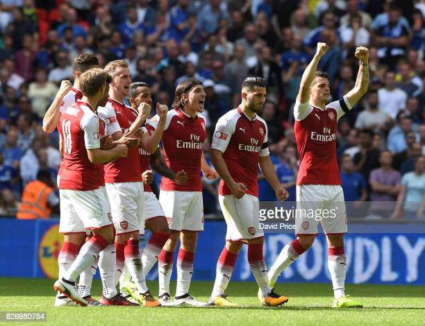 Rob Holding Hector Bellerin Sead Kolasinac and Granit Xhaka celebrate Arsenal's 3rd goal in the penalty shoot out during the match between Chelsea...