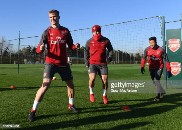 Rob Holding Jack Wilshere and Alexis Sanchez of Arsenal during a training session at London Colney on November 17 2017 in St Albans England