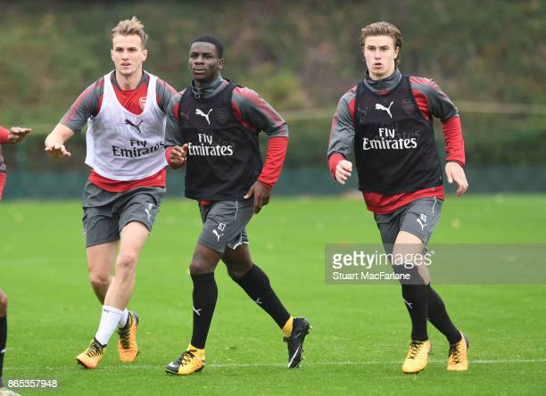 Rob Holding Jordi OseiTutu and Ben Sheaf of Arsenal during a training session at London Colney on October 23 2017 in St Albans England