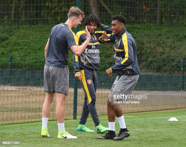Rob Holding Mohamed Elneny and Alex Iwobi of Arsenal during a training session at London Colney on May 9 2017 in St Albans England