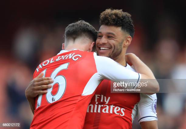 Rob Holding of Arsenal and Alex OxladeChamberlain of Arsenal celebrate after the Premier League match between Arsenal and Manchester United at the...
