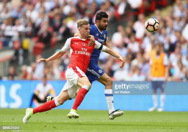 Rob Holding of Arsenal and Diego Costa of Chelsea compete for the ball during The Emirates FA Cup Final between Arsenal and Chelsea at Wembley...