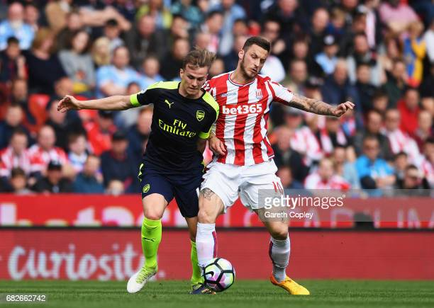 Rob Holding of Arsenal and Marko Arnautovic of Stoke City battle for possession during the Premier League match between Stoke City and Arsenal at...