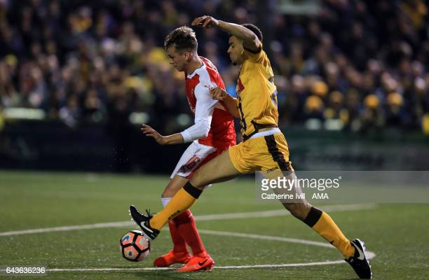 Rob Holding of Arsenal and Maxime Biamou of Sutton United during The Emirates FA Cup Fifth Round match between Sutton United and Arsenal on February...