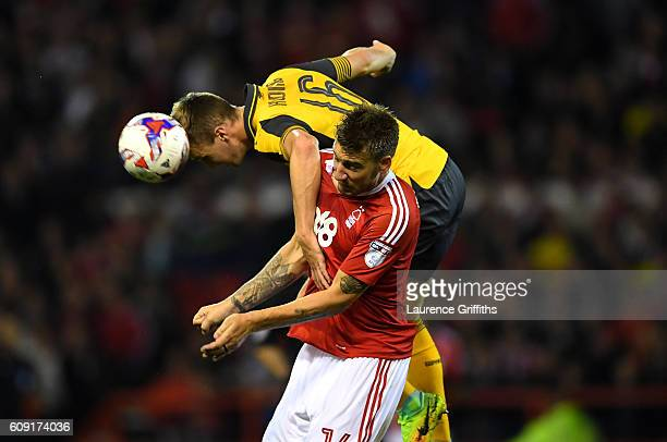 Rob Holding of Arsenal and Nicklas Bendtner of Nottingham Forest in action during the EFL Cup Third Round match between Nottingham Forest and Arsenal...