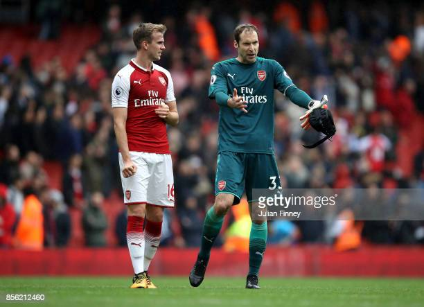 Rob Holding of Arsenal and Petr Cech of Arsenal speak to each other after the Premier League match between Arsenal and Brighton and Hove Albion at...
