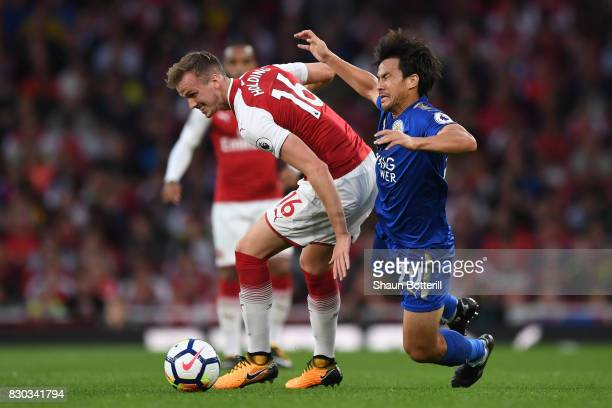 Rob Holding of Arsenal and Shinji Okazaki of Leicester City battlefor the ball during the Premier League match between Arsenal and Leicester City at...